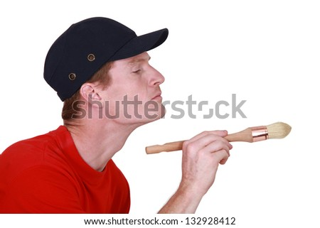 A painter at work. - stock photo