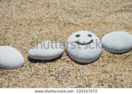a painting funny smile on the stone - stock photo
