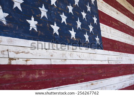 A painting of an American flag on a wood plank wall - stock photo