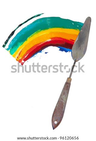 a painting palette knife isolated on a white background painting a rainbow - stock photo