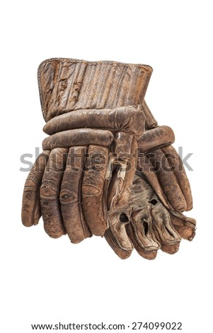 A pair of antique hockey gloves is isolated on a white background.