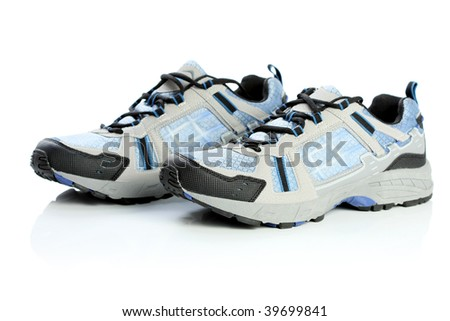 A pair of athletic shoes, isolated on white - stock photo