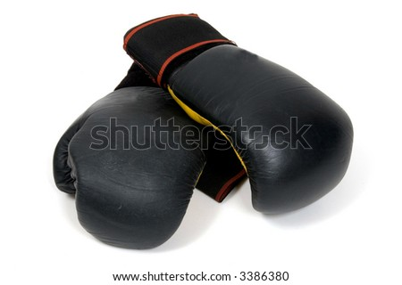 A pair of black boxing gloves shot against a white background - stock photo