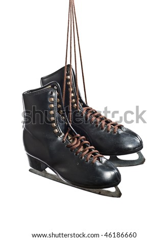 A pair of black figure skates hanging by laces, isolated on white - stock photo