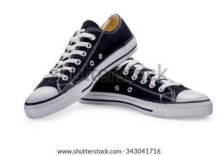 A pair of black gumshoes with shoelace on a white background