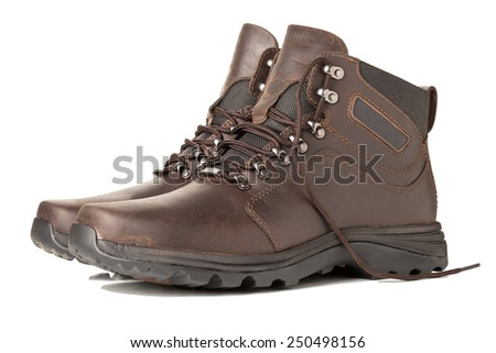 A Pair of Brown Hiking Boots Isolated on a White Background - stock photo
