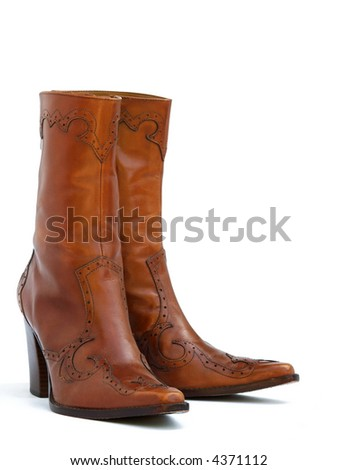 a pair of brown leather cowgirl boots - stock photo