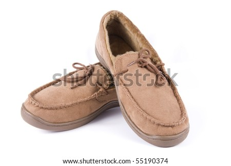 A pair of brown suede comfortable slippers isolated on a white background - stock photo