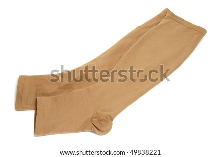 a pair of compression stockings isolated on a white background - stock photo