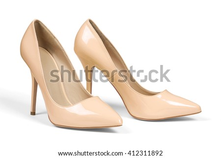 A pair of creamy high heel shoes isolated on white with clipping path.