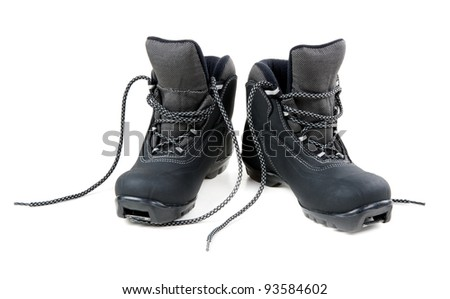A pair of cross country ski boots isolated on white background - stock photo