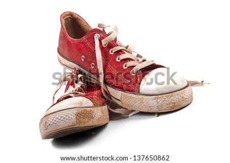 a pair of dirty sneakers - stock photo