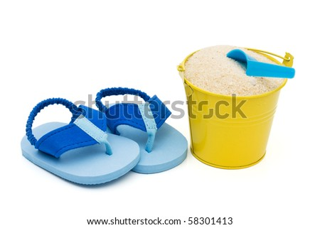 A pair of flip-flops and bucket of sane on a white background, Enjoying the beach - stock photo