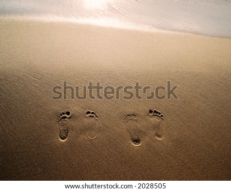 A pair of footprints as a short lasting reminder of our presence on a Tunisian sandy beach.