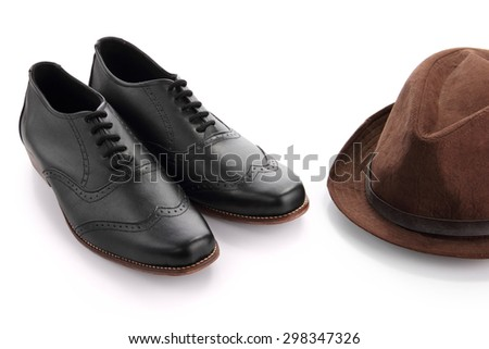 A pair of formal shoes with fedora hat, isolated on white background - stock photo