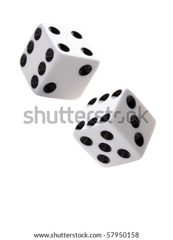 A pair of gambling dices falling down against white background. - stock photo
