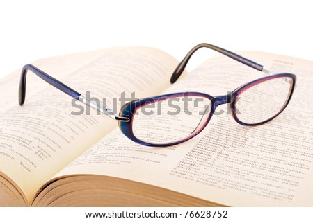 A pair of glasses on a book concepts of knowledge and education - stock photo