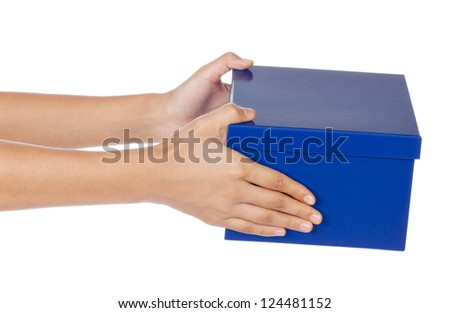 A pair of hands holding a out a plain blue box as a gift isolated on white. - stock photo