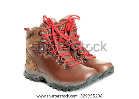 A pair of hiking boots. Isolated on white background - stock photo
