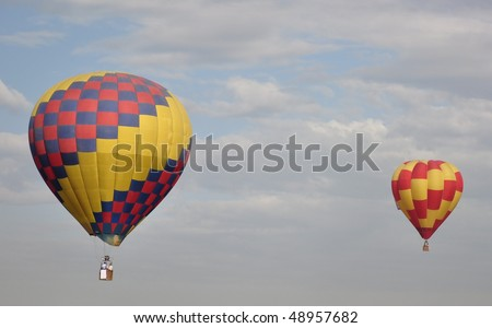 A pair of hot ar balloons - stock photo