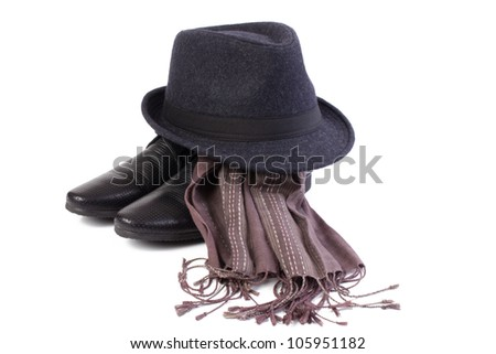 A pair of men's shoes and a classic hat isolated on white background