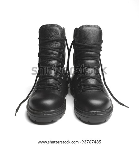 A pair of new black workmans boots on a white background - stock photo