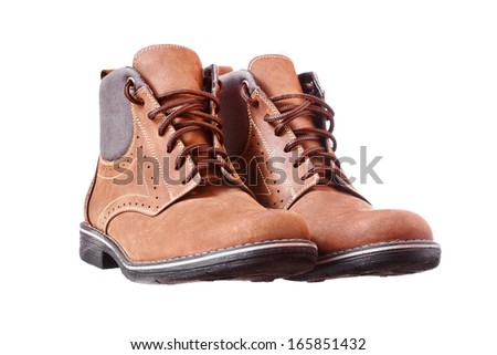 A pair of new brown hiking boots on white background - stock photo