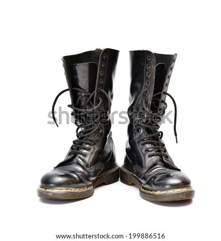 A pair of old and rugged men's/unisex mid-calf black 14 eyelet lace-up combat/ranger boots - stock photo