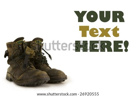 A pair of old boots on a white background, to contrast with your shiny new product - stock photo
