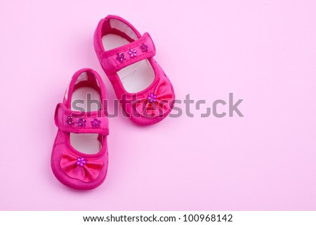 a pair of pink baby shoes