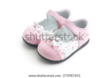A pair of pink shoes,isolated on white background.There are some flowers on the vamp,they are decorative patterns,and not the mark of commodity. - stock photo