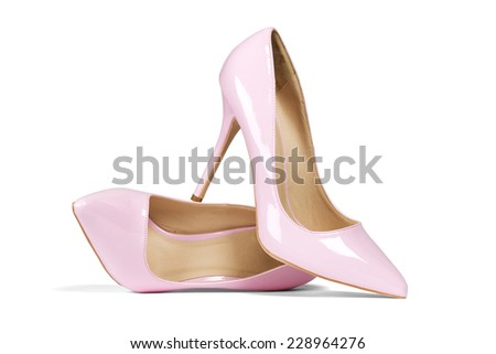 A pair of pink women's heel shoes isolated over white with clipping path. - stock photo