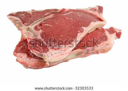 A pair of raw t-bone steaks against a white background. - stock photo