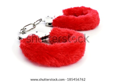 a pair of red sexy fluffy handcuffs on a white background - stock photo