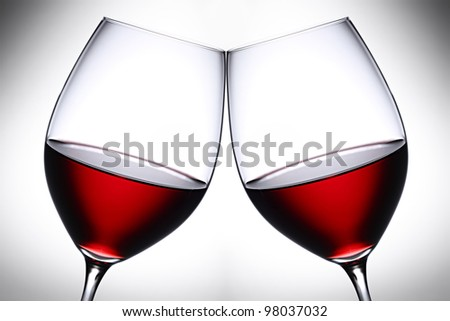 a pair of red wine glasses - stock photo