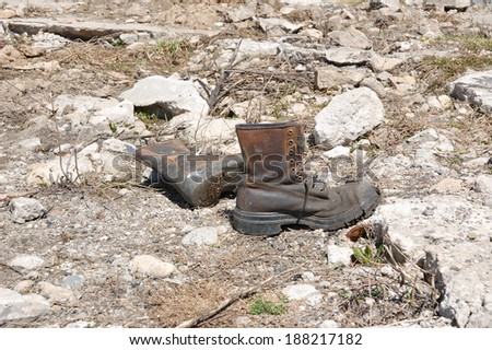 A pair of rough boots - stock photo