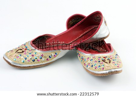 A pair of ruby oriental  shoes - stock photo