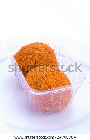 A pair of scotch eggs in supermarket packaging - stock photo