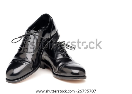 a pair of shining back dress business shoes on a white background - stock photo