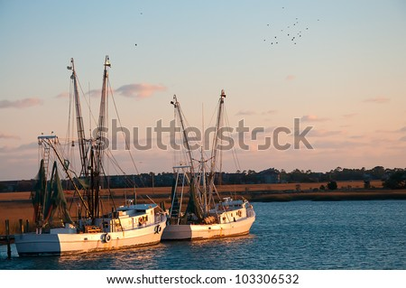 A Pair of Shrimp Boats out on the Saltwater Creek - stock photo