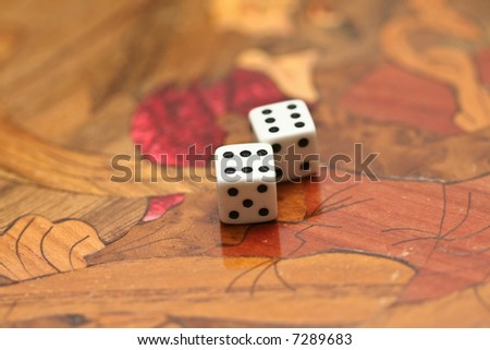 a pair of sixes on a backgammon board - stock photo