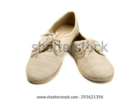 A pair of summer shoes beige lace and fabric. Isolate on white. - stock photo