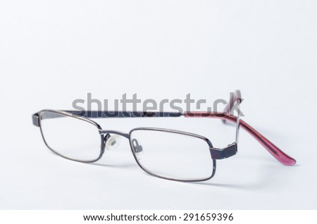 A pair of transparent glasses on white  paper background