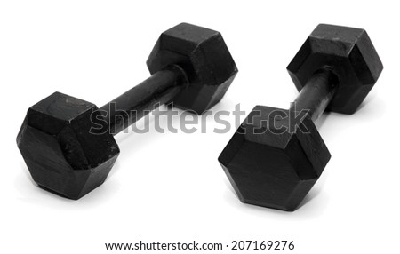 A pair of two black dumbbells on a white background. - stock photo