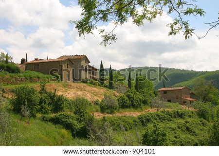 A pair of villas high up in the hills of Tuscany, Italy - stock photo