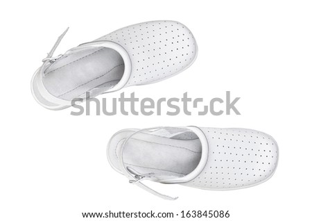 A pair of white professional comfortable shoes isolated over white - stock photo