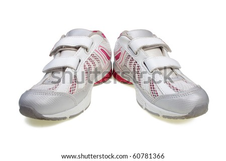 A pair of women's running shoes isolated on white. - stock photo