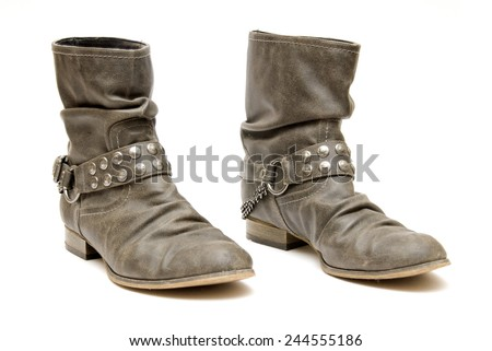 A pair of Womens Ankle boots with chains across them
