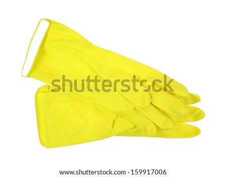 A pair of yellow latex gloves palms up single top folded edge on white background.