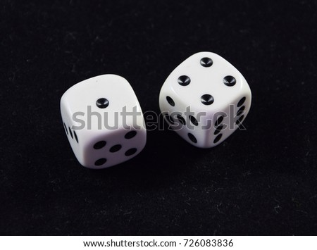 A pair white of dice showing Four and One